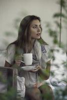 Woman enjoying hot drink outdoors