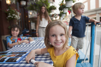 Little girl sitting at outdoor cafe, portrait