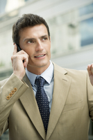 Businessman talking on cell phone, portrait