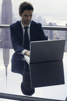 Businessman using laptop computer
