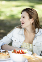 Woman enjoying meal outdoor with friends