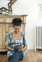 Woman streaming video on digital tablet
