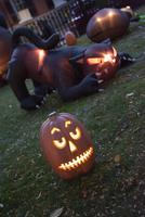 Illuminated jack-o-lantern and Halloween decorations