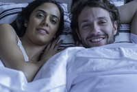 Couple together in bed, portrait