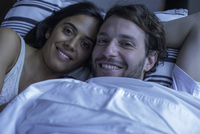 Couple in bed together, portrait