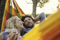 Couple relaxing together in hammock
