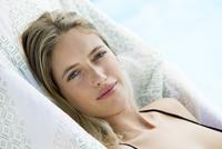 Woman sunbathing, portrait