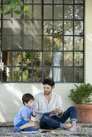 Father reading book to son