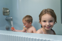 Young siblings taking a bath