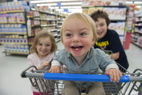 Children having fun in shopping cart