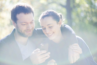 Couple using mobile app on smartphone for navigation