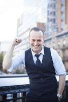 Businessman with fist raised in celebration, portrait