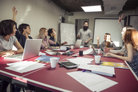 Colleagues brainstorming in meeting