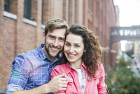 Couple smiling together outdoors, portrait