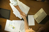 Business associates shaking hands during meeting 11001065410| 写真素材・ストックフォト・画像・イラスト素材|アマナイメージズ