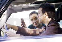 Couple on road trip using smartphone app to navigate