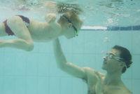Father teaching son to swim