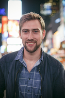 Young man in Times Square, New York City, New York, USA