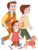 犬と散歩する家族