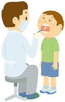 歯科検診を受ける男の子