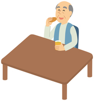 お茶菓子を食べる老人男性