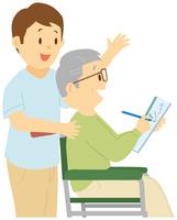 水彩画を描く老人男性と介護士