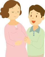 妊婦の妻とお腹に触れる夫