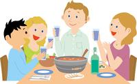 ホストファミリーと食事をする男子学生