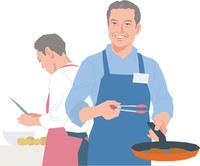 料理教室で調理するアクティブシニアの男性