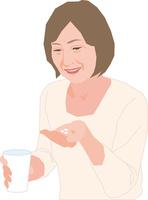 薬を飲むアクティブシニアの女性