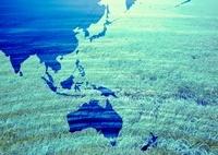 世界地図と草原のイメージ