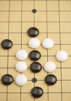 Go board with chess pieces
