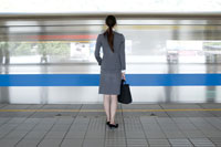 woman with briefcase on  platform