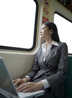 Businesswoman sitting on train by window
