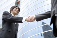 Businessman shaking hands with a man