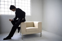 Businessman leaning on sofa