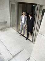 Businesspeople walking out of building