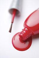 A pouring nail polish bottle
