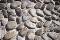 Irregular rocks set into cemnet wall
