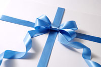 Wrapped gift with blue ribbon