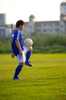 Soccer ball on player's knee