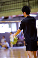 Man prepares to serve during a game