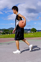 boy holding basketball outdoors