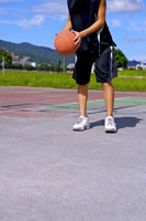 boy preparing to throw basketball