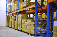 Warehouse shelves stacked with boxes