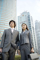businesspeople standing with briefcase