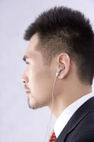 businessman using headphones 11010010777| 写真素材・ストックフォト・画像・イラスト素材|アマナイメージズ