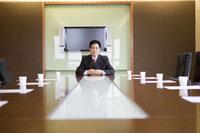 Businessman sitting alone in boardroom