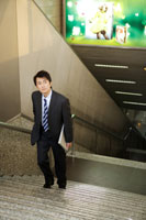 businessman standing on staircase