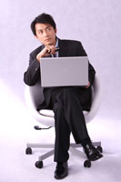businessman sitting with laptop